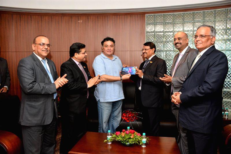 Actor Rishi Kapoor launch the IDBI debit card along with M S Raghavan, CMD, IDBI Bank in Mumbai, on July 1, 2014.