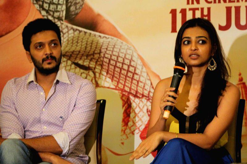 Actor Riteish Deshmukh and Radhika Apte during a press conference to promote their upcoming Marathi film `Lai Bhaari` in Pune on July 4, 2014. - Riteish Deshmukh