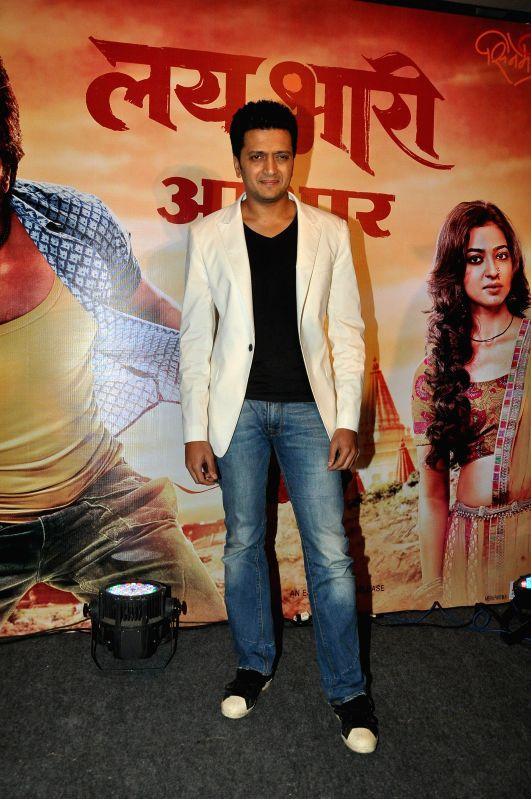 Actor Riteish Deshmukh celebrates the success of Marathi film Lai Bhari in Mumbai on July 14, 2014.