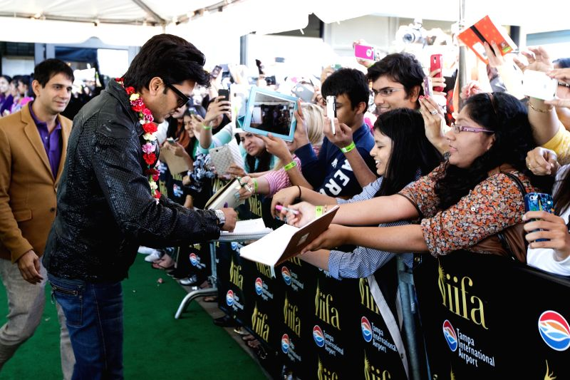 Actor Riteish Deshmukh signs autographs as he arrives to attend the 15th Annual IIFA weekend in Florida of United States of America. - Riteish Deshmukh