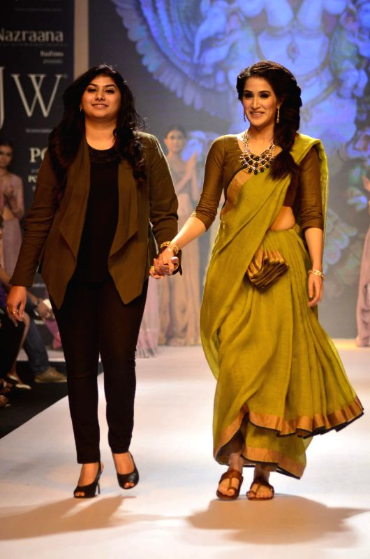 Actor Sagarika Ghatge displays the creations of Ganjam Jewellers during the India International Jewellery Week (IIJW) in Mumbai, on July 15, 2014.