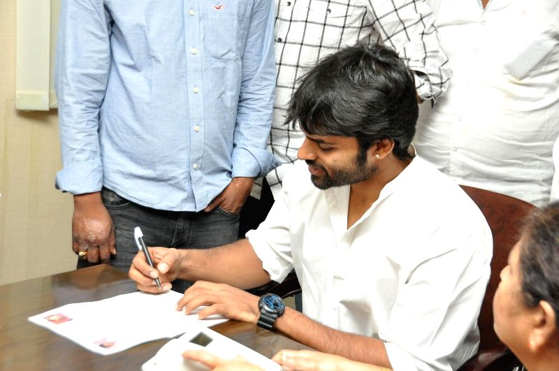 Actor Sai Dharam Tej and Pawan Kalyan Fans donated stretchers to Gandhi Hospital on event of Pavan Kalyans birthday Hyderabad on Sept 2, 2014. - Sai Dharam Tej