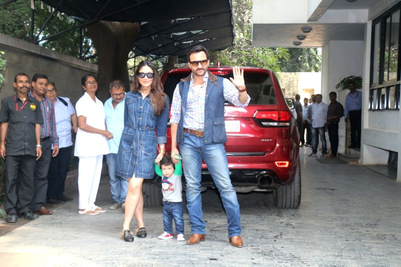 Actor Saif Ali Khan along with his wife Kareena Kapoor Khan and son Taimur at Shashi Kapoor's Christmas Party held at his residence in Mumbai on Dec 25, 2017. - Saif Ali Khan, Kareena Kapoor Khan and Shashi Kapoor