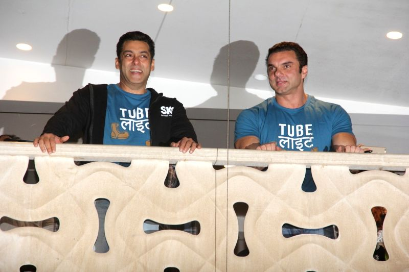 Actor Salman Khan and brother and actor Sohail Khan celebrate the launch of Tubelight trailer, in Mumbai on May 25, 2017. - Salman Khan and Sohail Khan