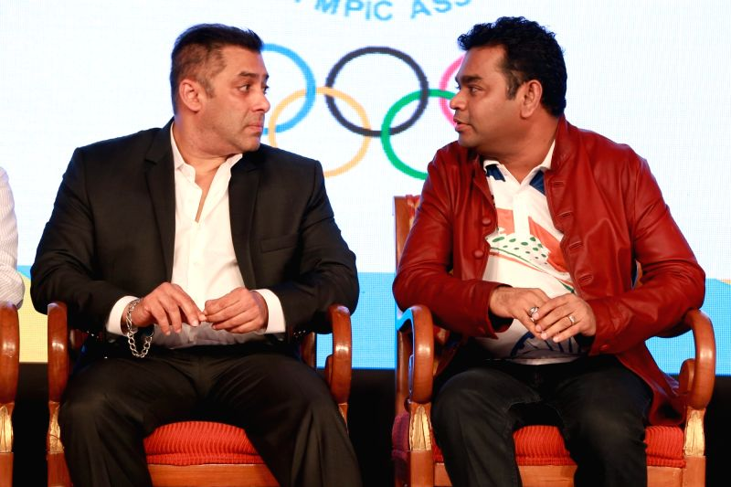 Actor Salman Khan and composer AR Rahman during the sendoff ceremony of Indian Contingent for Rio Olympics 2016, organised by Indian Olympic Association, in New Delhi on July 18,2016. - Salman Khan