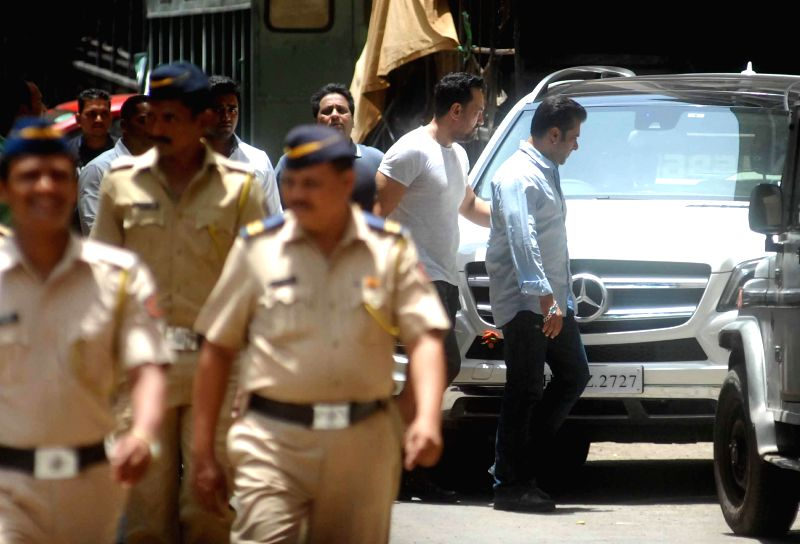 Actor Salman Khan arrives to appear before a Mumbai court in connection with a 2002 hit-and-run case on June 24, 2014.