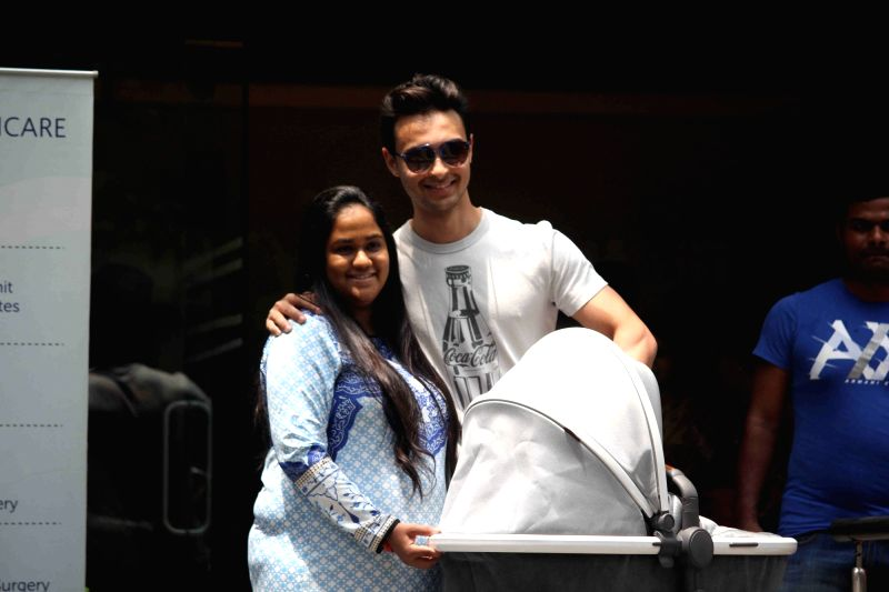Actor Salman Khan`s sister Arpita Khan Sharma along with her husband Aayush Sharma get discharge from the hospital, in Mumbai, on April 5, 2016. - Salman Khan, Arpita Khan Sharma and Aayush Sharma