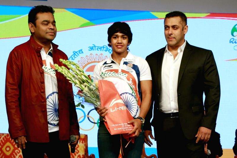 Actor Salman Khan, wrestler Vinesh Phogat and composer AR Rahman during the sendoff ceremony of Indian Contingent for Rio Olympics 2016, organised by Indian Olympic Association, in New ... - Salman Khan