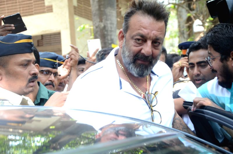 Actor Sanjay Dutt arrives to appear before a Mumbai court in response to an arrest warrant issued against him two days ago on April 17, 2017.  The warrant was later cancelled by the court. - Sanjay Dutt