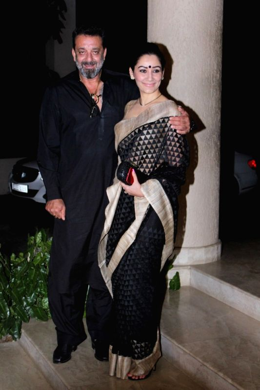 Actor Sanjay Dutt with his wife Manyata Dutt during the celebration of the film Bhoomi completion in Mumbai on May 5, 2017. - Sanjay Dutt and Manyata Dutt