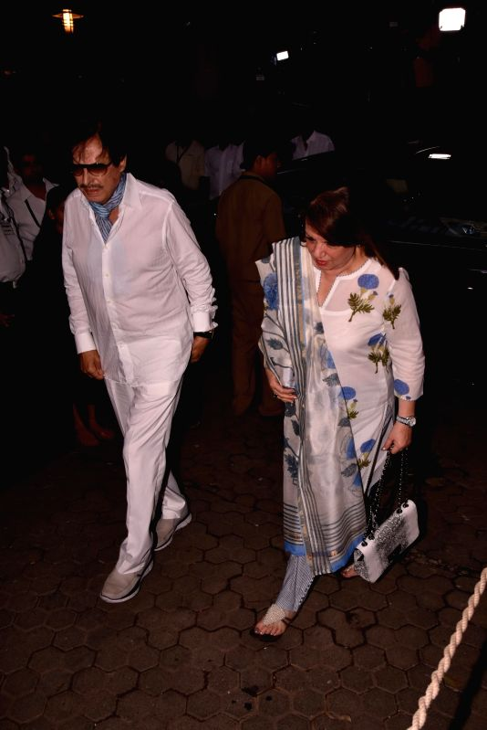 Actor Sanjay Khan along with his wife Zarine Katrak arrives to attend Late actor Shashi Kapoor's condolence meeting in Mumbai on Dec 7, 2017. - Sanjay Khan and Shashi Kapoor