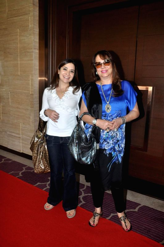 Actor Sanjay Khan's wife Zarine Khan with her daughter in law Malaika Parekh during the co-host power luncheon for women in Mumbai on April 30, 2014. - Sanjay Khan and Zarine Khan