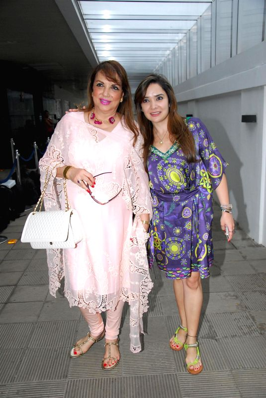 Actor Sanjay Khan's wife Zarine Khan with her daughter in law Malaika Parekh during the birthday celebration of artist Rouble Nagi in Mumbai on July 7, 2014. - Sanjay Khan and Zarine Khan