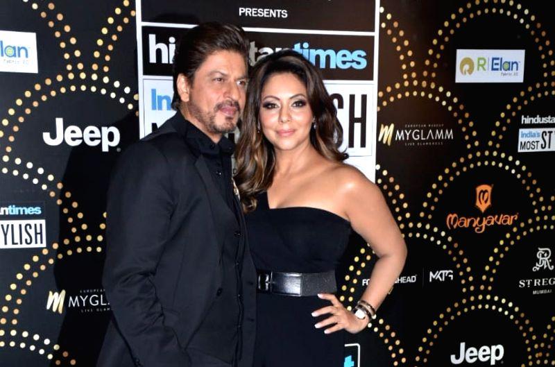 Actor Shah Rukh Khan along with his wife Gauri Khan. (Image Source: IANS)