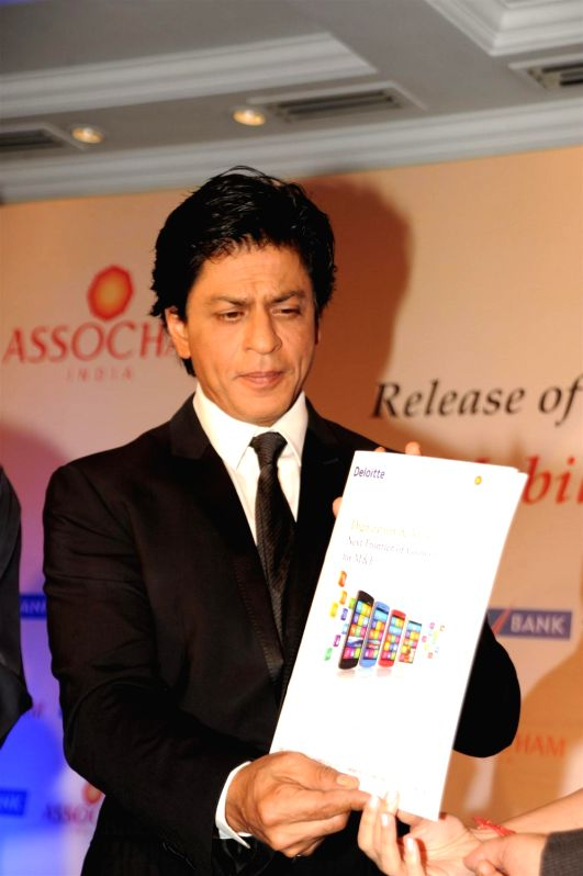 Actor Shah Rukh Khan during the launch of ASSOCHAM coffee table book on media and entertainment in Mumbai on Nov 23, 2015. - Shah Rukh Khan