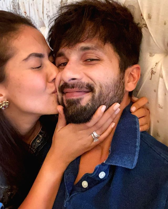 Actor Shahid Kapoor on Friday posted a picture with wife Mira Rajput kissing on the cheek, and the fans are not surprisingly gushing.