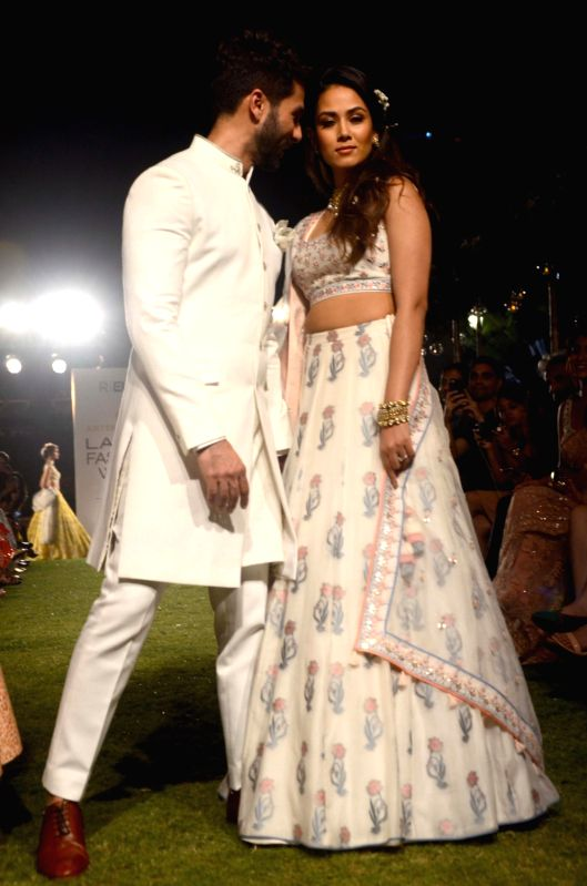 Actor Shahid Kapoor with his wife Mira Rajput walk the ramp for fashion designer Anita Dongre during the Lakme Fashion Week Summer/Resort 2018 in Mumbai on Jan 31, 2018. - Shahid Kapoor