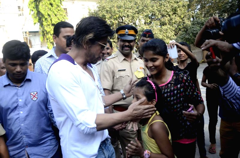 Actor Shahrukh Khan arrives at a polling booth to cast his vote during the sixth phase of 2014 Lok Sabha Polls in Mumbai on April 24, 2014.