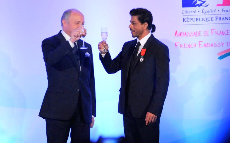 Actor Shahrukh Khan conferred with Chevalier de la Legion d`Honneur, the highest Honour in France by H. E. Laurent Fabius, Minister for Foreign Affairs and International Development of France in ...