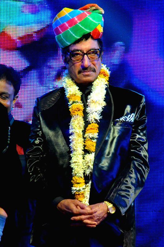 Actor Shakti Kapoor performs during Jaipur Laughter Festival 2015 in Jaipur, on Jan 11, 2015. - Shakti Kapoor