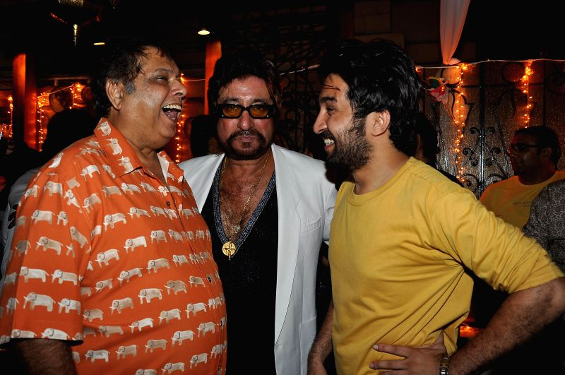Actor Shakti Kapoor with filmmaker David Dhavan and Shakti Kapoor's son Siddhanth Kapoor during a success party hosted by Sanjay Gupta to celebrate the success of writer Milap Zaveri's films 'Main ... - Shakti Kapoor, Siddhanth Kapoor and Sanjay Gupta