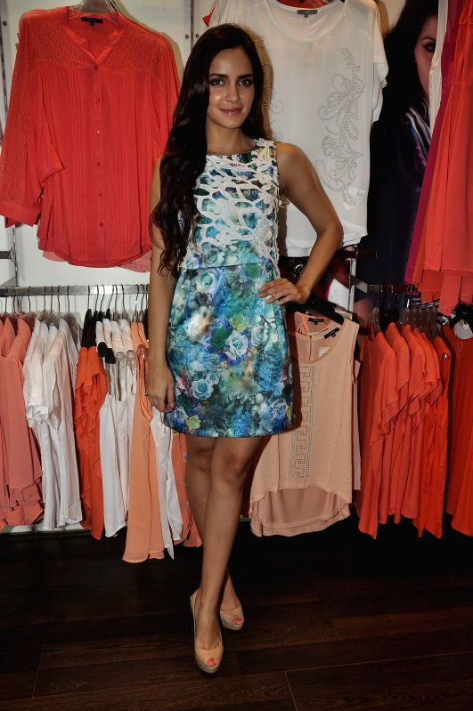 Actor Shazahin Padamsee poses while shopping at a Madame outlet, on the eve of Friendship day in Mumbai, on August 2, 2014.