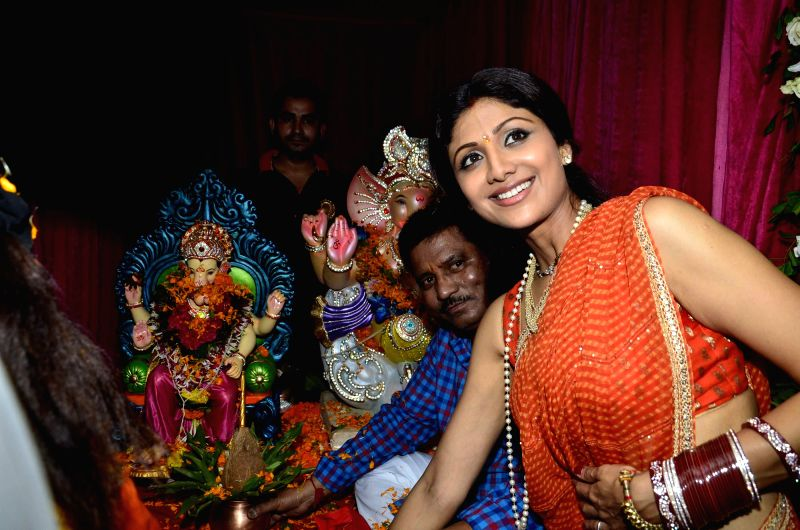 Actor Shilpa Shetty durig the immersion of an idol of the elephant-headed Hindu god Lord Ganesh after one and half day in Mumbai on August 30, 2014. - Shilpa Shetty