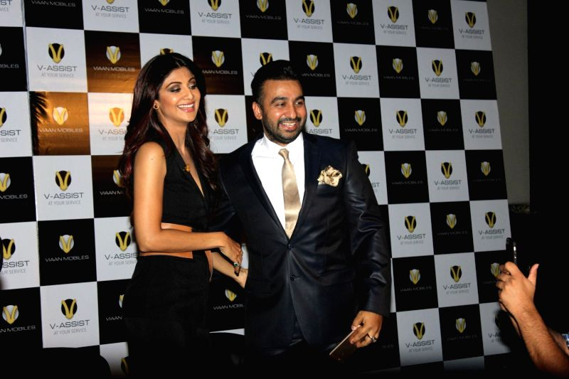 Actor Shilpa Shetty with her husband Raj Kundra during the launch of Viaan Mobile phones named after Shilpa Shetty and Raj Kundra son`s name in Mumbai on November 25, 2015. - Shilpa Shetty and Raj Kundra