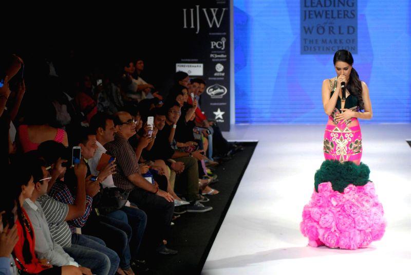 Actor Shraddha Kapoor displays the creations of Gitanjali Jewellers during the India International Jewellery Week (IIJW) in Mumbai, on July 15, 2014.