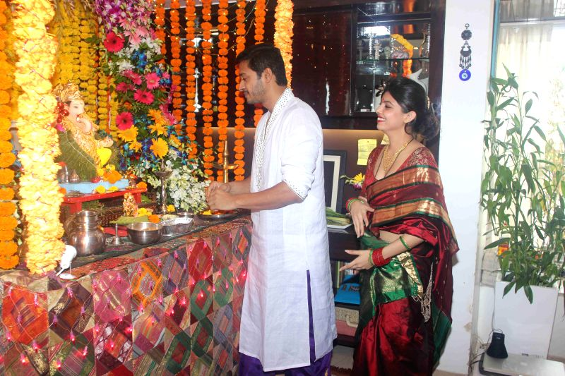 Actor Shreyas Talpade along with his wife Deepti during the Ganesh Chaturthi celebrations at his residence in Mumbai on Aug 29, 2014.