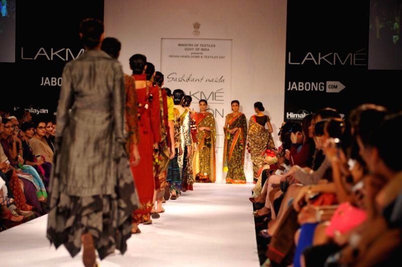 Actor Shriya Saran displays the creation of fashion designer Sashikant Naidu during the Lakme Fashion Week (LFW) Winter/ Festive 2014 in Mumbai, on Aug. 21, 2014. - Shriya Saran