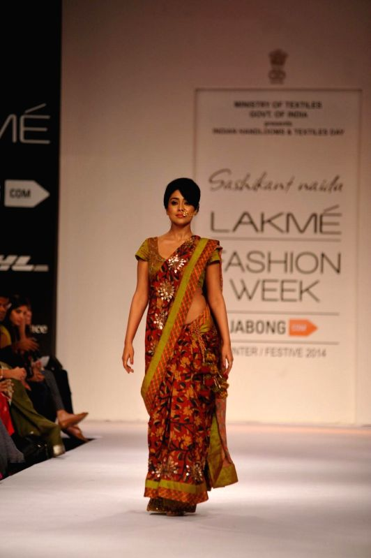 Actor Shriya Saran displays the creation of fashion designer Sashikant Naidu during the Lakme Fashion Week (LFW) Winter/ Festive 2014 in Mumbai, on Aug. 21, 2014. - Shriya Saran