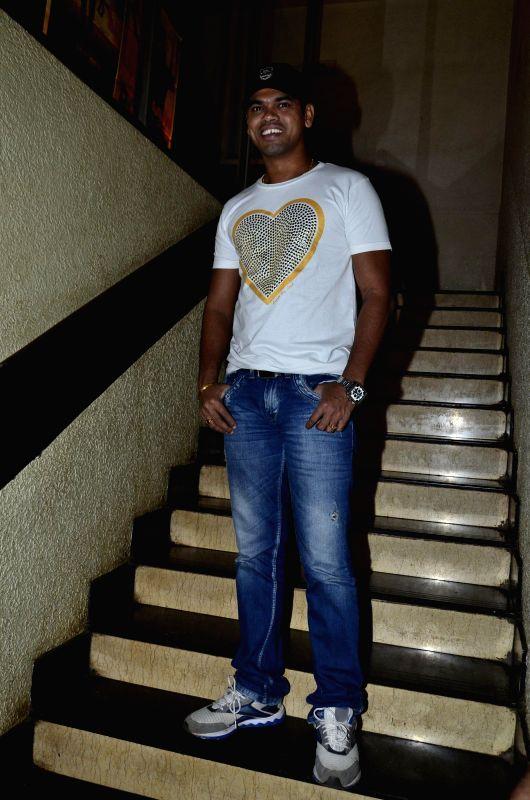 Actor Siddharth Jadhav during the special screening of the Marathi film Saturday Sunday in Mumbai on August 6, 2014. - Siddharth Jadhav