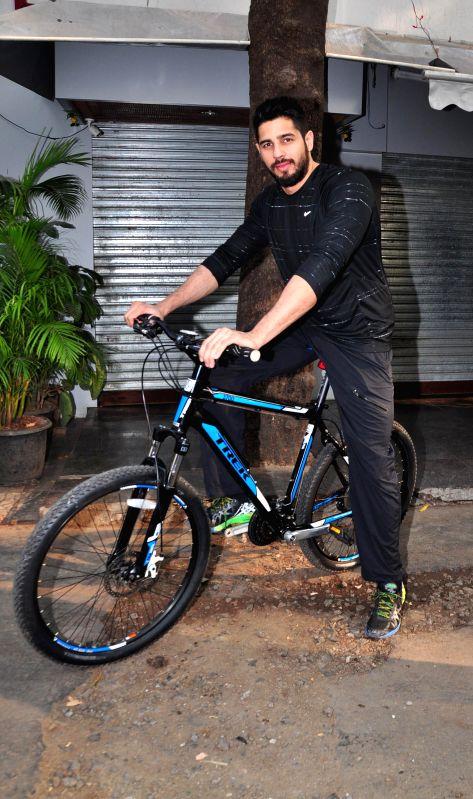 Actor Sidharth Malhotra cycles at The Equal Street Movement in Bandra, Mumbai on Nov. 24, 2014.