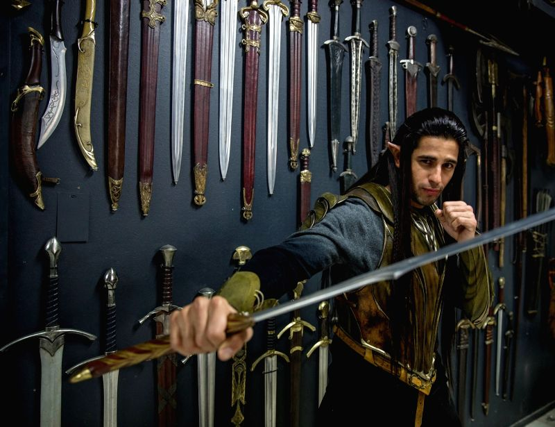 "Actor Sidharth Malhotra with Aragorn's sword from ""Lord Of The Rings"" at Weta Workshop. Don't miss the other real props behind him. - Sidharth Malhotra"