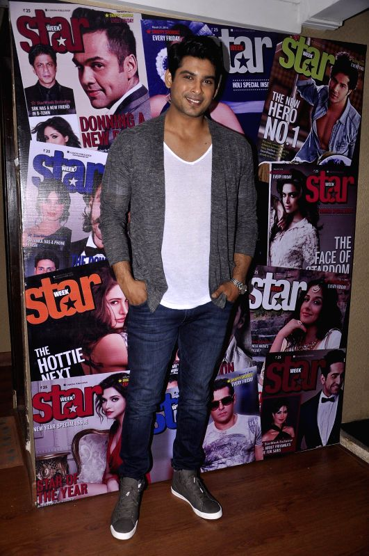 Actor Sidharth Shukla during the unveiling of latest cover of Star Week magazine in Mumbai on July 31, 2014. - Sidharth Shukla