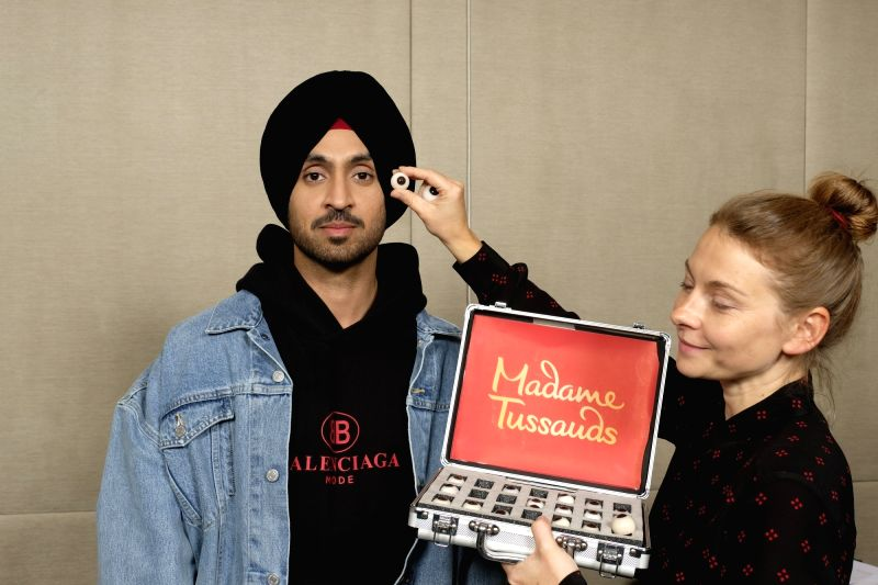 Actor-singer Diljit Dosanjh during a session where he gave measurements to Madame Tussauds expert artists for the sitting for his figure, in Mumbai on July 15, 2018. His wax statue is all set ...