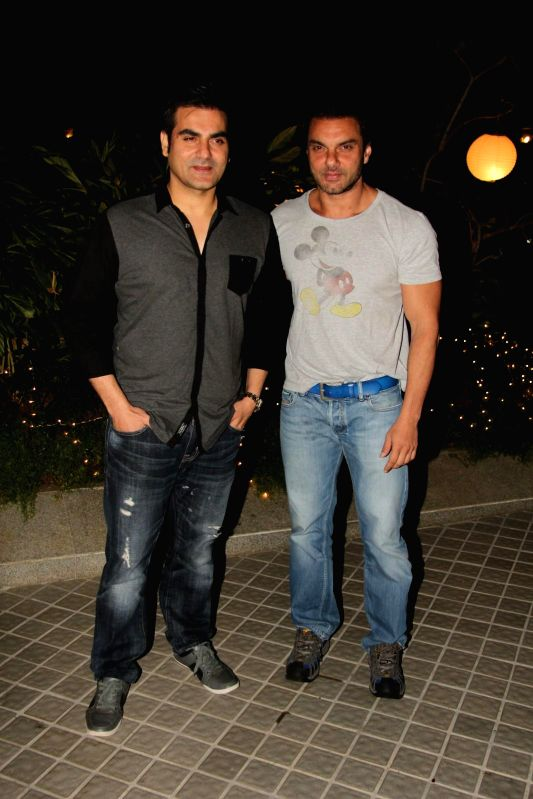 Actor sohail khan and arbaaz khan during the birthday party of Farah Khan in Mumbai, on jan. 08, 2015.