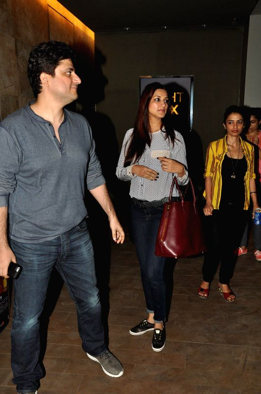Actor Sonali Bendre and her husband Goldie Behl during the special screening of the movie Ek Villain in Mumbai on June 24, 2014. - Sonali Bendre