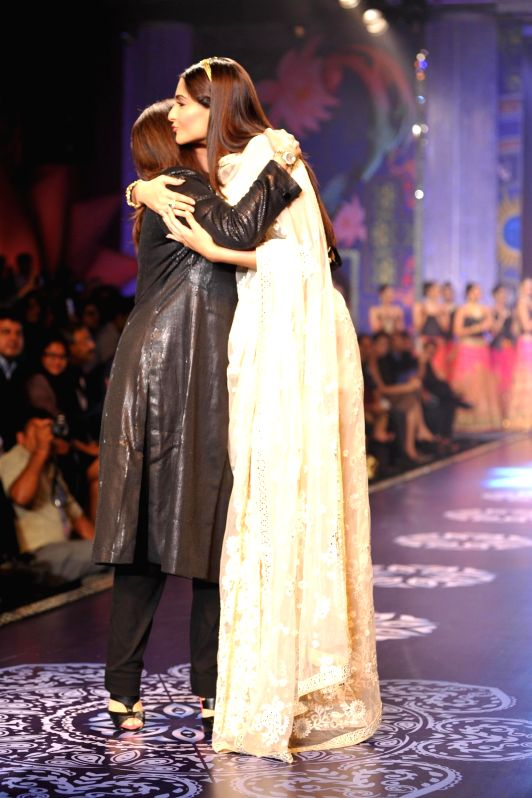 Actor Sonam Kapoor with fashion designer Neeta Lulla during the grand finale of India International Jewellery Week (IIJW) in Mumbai on July 17, 2014.