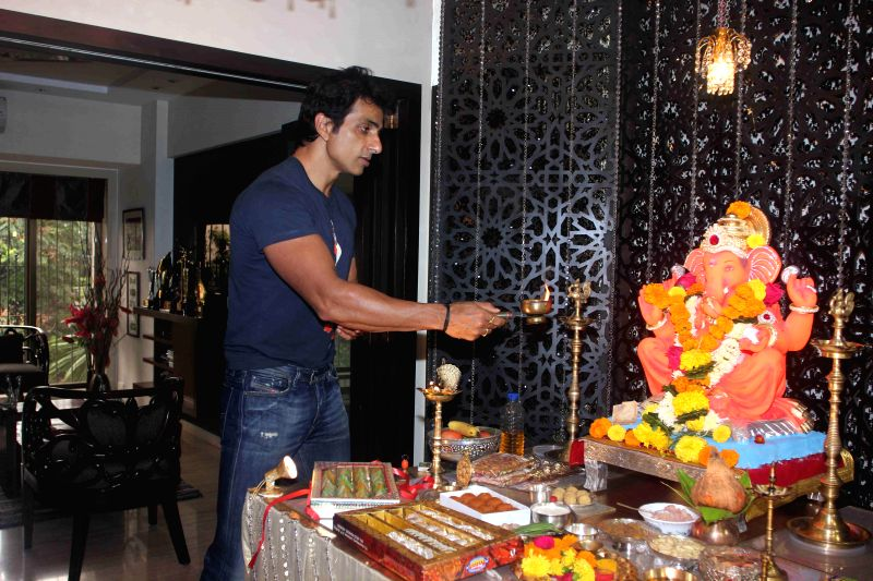 Actor Sonu Sood during the Ganesh Chaturthi celebrations at his residence in Mumbai on Aug 29, 2014.