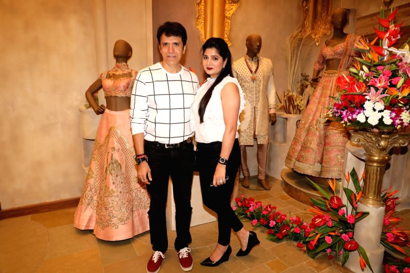 Actor Sooraj Thapar with his wife Deepti Dhyani at the launch of a designer store, in Mumbai on July 21, 2018. - Sooraj Thapar