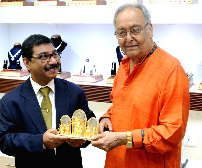 """Actor Soumitra Chatterjee and P.C. Chandra Jewellers Managing Director Suvro Chandra during the launch of Experience the grandeur of Rajasthan and re-live the magic of """"Sonar ... - Soumitra Chatterjee"""