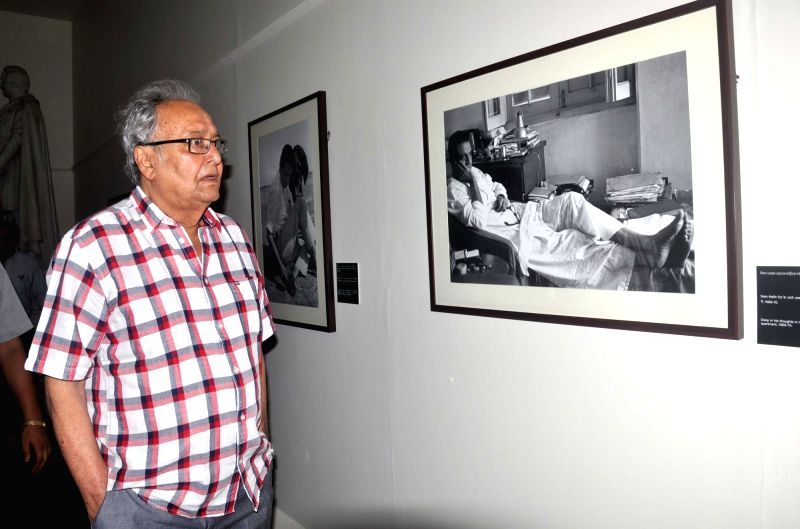 "Actor Soumitra Chatterjee during inauguration of Nemai Ghosh's photo exhibition ""Satyajit Ray: The Many Moods of a Maestro"" in Kolkata, on May 30, 2017. - Soumitra Chatterjee and Nemai Ghosh"