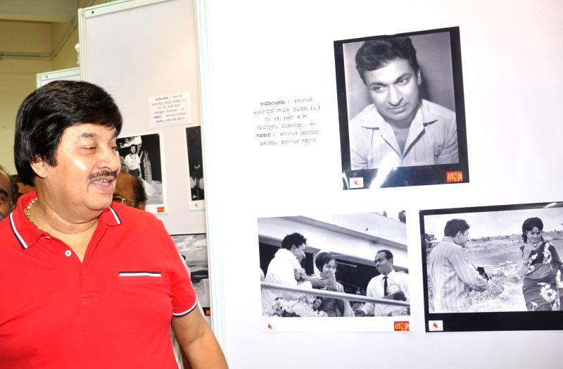 Actor Srinath visits a photo exhibition exhibiting rare photographs of Dr Rajkumar at Chitrakala Parishath in Bangalore on June 22, 2014. - Srinath