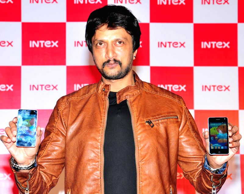 Actor Sudeep launches Intex's new mobile phone - Aqua Style in Bangalore on Aug 12, 2014.