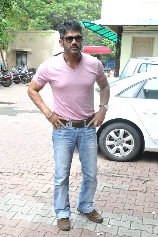 Actor Suniel Shetty during the Mumbai Mayor Cup Shooting Competition 2014 to encourage the shooter and promote upcoming film Desi Kattey in Mumbai on July 14, 2014. - Suniel Shetty