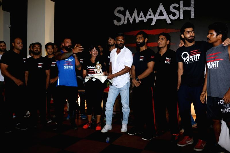 Actor Suniel Shetty with fitness trainers Shivoham and Vrinda Mehta during the launch of a gym in Mumbai on May 17, 2017. - Suniel Shetty and Vrinda Mehta