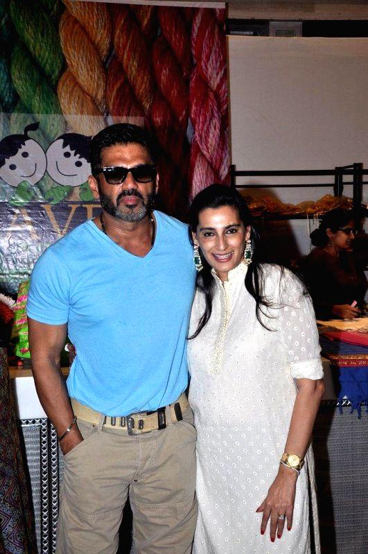 Actor Sunil Shetty along with his wife Mana Shetty at her Araaish Exhibition, in Mumbai, on Aug. 26, 2014. - Sunil Shetty