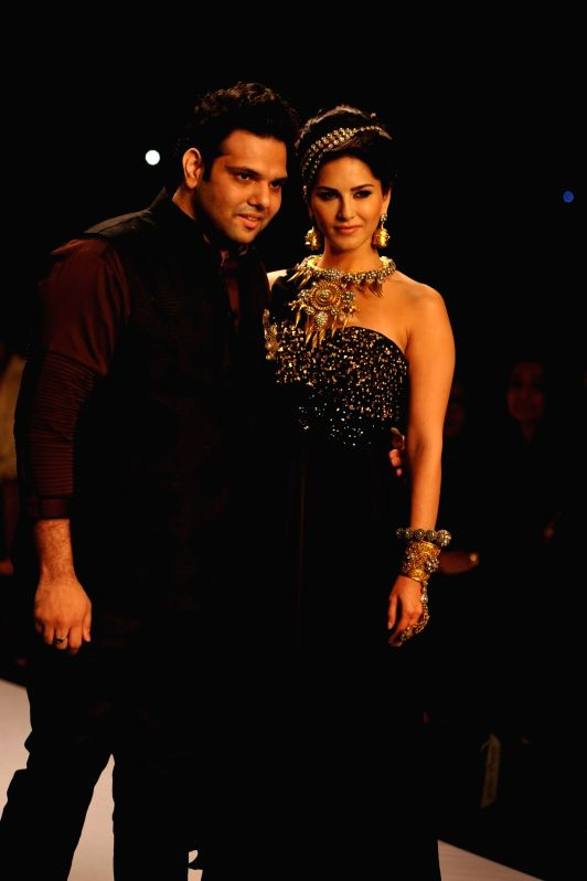 Actor Sunny Leone display jewellery by designer Sumit Sawhney during the India International Jewellery Week (IIJW) in Mumbai, on July 14, 2014.
